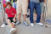 12 JUNE 2009 -- SCOTTSDALE, AZ: STEVEN KELLER, of Scottsdale, AZ, was the first person in line to get into the new Apple Store in Scottsdale, Friday. He stood in front of the store for six hours waiting for it to open. The outlet will be Arizona's largest Apple Store, occupying nearly 10,000 square feet in the Outdoor Lifestyle Center in the Scottsdale Quarter. The store, the fifth in the Phoenix area, uses a radically different design from other Apple Stores in some respects. Ceilings in the building are approximately 20 feet high, and lined with a 75-foot long skylight, reducing dependence on artificial lighting. Aiding the skylight is an all-glass front and rear, permitting visitors to see directly through the store. More than one thousand people lined to get into the store during the grand opening. Photo by Jack Kurtz