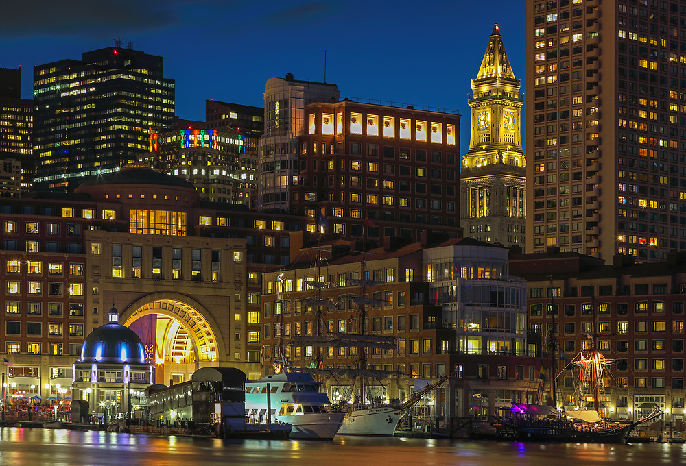 Sail Boston tall ships Europa and Atyla moored in the Boston Harbor waterfront skyline photography art  from New England photographer Juergen Roth. The image shows the historic sailboats in front of the Boston Financial Waterfront District landmarks such as the Custom House of Boston, One International Place, Boston Harbor Hotel with its icondic photographed on a beautiful summer sunset evening. <br /> <br /> Sail Boston photos are available as museum quality photo prints, canvas prints, wood prints, acrylic prints or metal prints. Fine art prints may be framed and matted to the individual liking and decorating needs:<br /> <br /> https://juergen-roth.pixels.com/featured/last-glimpse-of-sail-boston-juergen-roth.html<br /> <br /> All digital Boston tall ships photography images are available for photo image licensing at www.RothGalleries.com. Please contact me direct with any questions or request.<br /> <br /> Good light and happy photo making!<br /> <br /> My best,<br /> <br /> Juergen<br /> Prints: http://www.rothgalleries.com<br /> Photo Blog: http://whereintheworldisjuergen.blogspot.com<br /> Instagram: https://www.instagram.com/rothgalleries<br /> Twitter: https://twitter.com/naturefineart<br /> Facebook: https://www.facebook.com/naturefineart