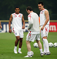 Photo: Chris Ratcliffe.<br />England Training Session. FIFA World Cup 2006. 28/06/2006.<br />Wayne Rooney and Theo Walcott (L) and John Terry in training.