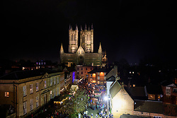 Images of the 2019 Lincoln Christmas Market taken from the wall walk at Lincoln Castle looking towards Lincoln Cathedral with visitors to the market in Castle Square.<br /> <br /> Picture: Chris Vaughan Photography<br /> Date: December 6, 2019