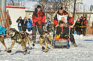 March 7th, 2009:  Anchorage, Alaska:  Mitch Seavey from Seward, Alaska steadies his sled as his team makes the turn onto Cordova Street during the start of the 2009 Iditarod Sled Dog Race.