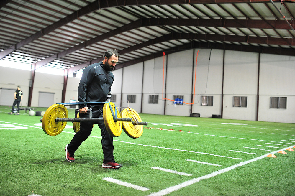 Johny Hendricks trains at Kennedale High School on November 11, 2014.