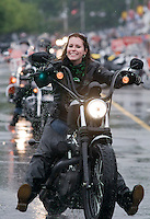 """The rains didn't dampen the """"spirit"""" of this biker as she made her way up Lakeside Avenue in Weirs Beach, NH during 2009 Bike Week.  (Karen Bobotas/for the Laconia Daily Sun)"""