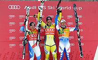 ALPINE SKIING - WORLD CUP 2011/2012 - LAKE LOUISE (CAN) - 27/11/2011 - PHOTO : MARCO TROVATI / PENTAPHOTO / DPPI - PODIUM MEN SUPER G  - Didier Cuche (Sui) / 2nd -  Aksel Lund Svindal (Nor) / WINNER - Adrien Theaux (Fra) / 3rd