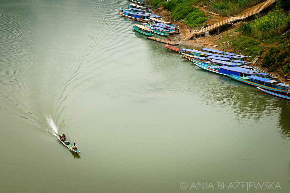 Laos, Nong Khiaw. Colourful boats at the local pier on Nam River. Most of them are carrying passengers between Luang Prabang and remote areas in the north of Laos.