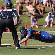 Aaron Redmond makes his ground during the Otago Voltz V Wellington Firebirds HRV Cup match at the Queenstown Events Centre, Queenstown, New Zealand. 31st December 2011