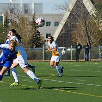 2nd year forward Sienne Krynowsky (14) of the Regina Cougars in action during the women's soccer home game on October 1 at U of R Field. Credit: Arthur Ward/Arthur Images