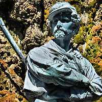 Giuseppe Zolli Statue at Giardini Pubblici in Venice, Italy <br /> Few tourists venture to Giardini Pubblici, a large park created in 1807 by Napoleon Bonaparte in Venice&rsquo;s eastern district called Castello Sestiere.  It is filled with shaded grass, walkways, pavilions from 30 nations and the Monumento a Giuseppe Garibaldi, a tribute to a 19th century Italian general.  This statue is Giuseppe Zolli, his closest guardian and one of his soldiers who were called Redshirts or Camice Rosse.  The park hosts the Venice Biennale Art Festival every other summer, which is an exhibition of contemporary art.