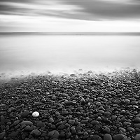 One yellow pebble sits against thousands of darker rocks. El Salvador.