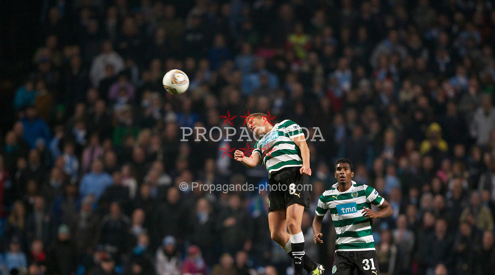 MANCHESTER, ENGLAND - Thursday, March 15, 2012: Sporting Clube de Portugal's Stijn Schaars and Renato Neto during the UEFA Europa League Round of 16 2nd Leg match against Manchester City at City of Manchester Stadium. (Pic by Vegard Grott/Propaganda)