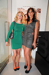 Left to right, NATALIE PRESS and LUCINDA BELL at a party to celebrate the launch of Bang a new male fragrance by Marc Jacobs held at the Fith Floor Restaurant, Harvey Nichols, Knightsbridge, London on 22nd July 2010.