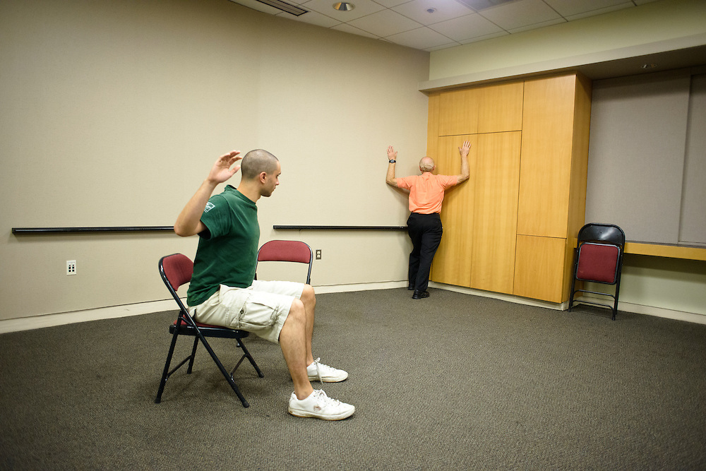 (photo by Matt Roth).Assignment ID: 30127886A..David H. Shulman, RPT, demonstrating a wall stretch the corner, conducts a physical therapy demonstration for BSO Academy participants like violinist Matt DeBeal, from Laurel, MD, at the Meyerhof Symphony Hall Tuesday, June 26, 2012.