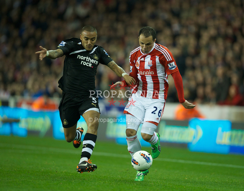 STOKE-ON-TRENT, ENGLAND - Monday, October 31, 2011: Stoke City's Matthew Etherington in action against Newcastle United's Danny Smimpson during the Premiership match at the Britannia Stadium. (Pic by David Rawcliffe/Propaganda)