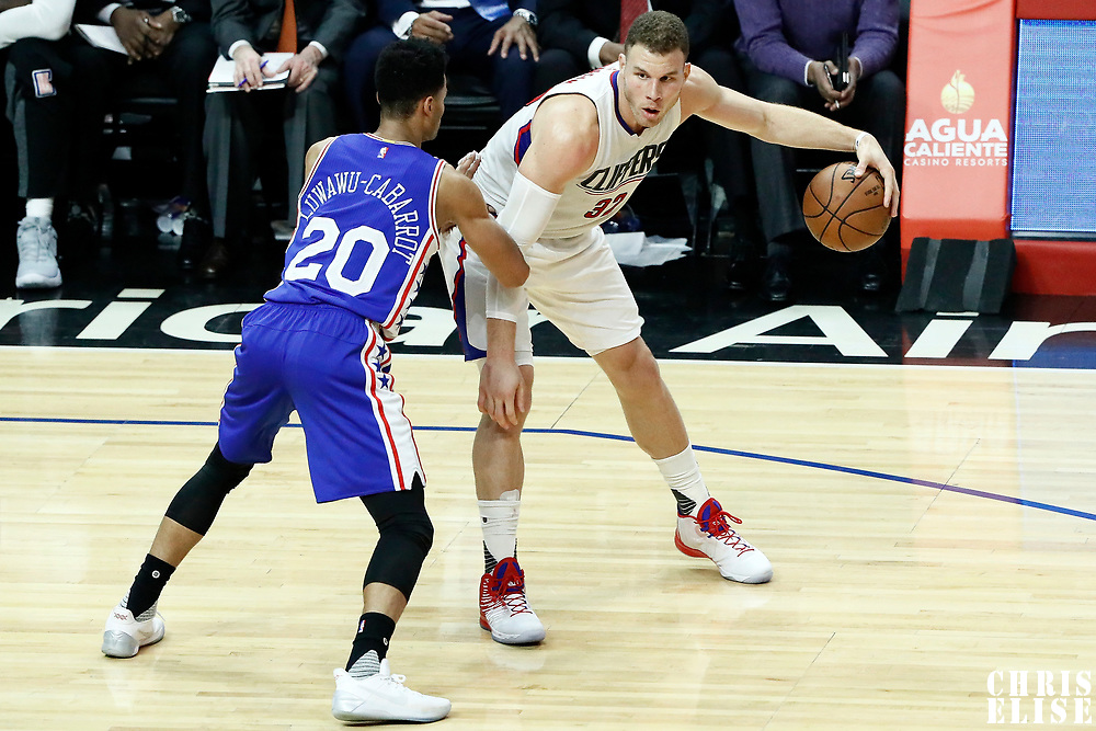 11 March 2017: Philadelphia 76ers guard Timothe Luwawu-Cabarrot (20) defends on LA Clippers forward Blake Griffin (32) during the LA Clippers 112-100 victory over the Philadelphia Sixers, at the Staples Center, Los Angeles, California, USA.
