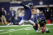 Seattle Seahawks punter Michael Dickson (4) holds as Seattle Seahawks kicker Sebastian Janikowski (11) kicks a 27 yard second quarter field goal that ties the score at 3-3 during the NFL football NFC wild card playoff game against the Dallas Cowboys on Saturday, Jan. 5, 2019 in Arlington, Tex. The Cowboys won the game 24-22. (©Paul Anthony Spinelli)