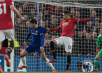 Football - 2017 / 2018 Premier League - Chelsea vs Manchester United<br /> <br /> Chris Smalling (Manchester United) has a handful of Alvaro Morata (Chelsea FC)  shirt as he tries to control the ball in front of goal at Stamford Bridge <br /> <br /> COLORSPORT/DANIEL BEARHAM