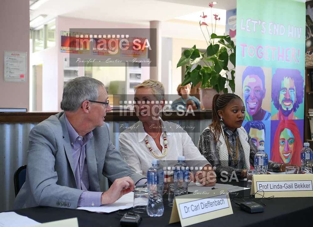 CAPE TOWN, SOUTH AFRICA - Wednesday 30 November 2016, Dr Carl W Dieffenbach, Director of the Division of AIDS in the United States National Institute for Allergy and Infectious Diseases and Prof Linda-Gail Bekker, Protocol Co-Chair for HVTN 702 and Deputy Director of the Desmond Tutu HIV Centre discuss a topic as Ms Launa Jack, (21) a participant in the HVTN 702 study and a second year Public Relations student at the Cape Peninsula University of Technology (CPUT) listens during the launch of a major study to test the efficacy of a vaccine to prevent HIV infection at the Emavundleni Research Centre in Old Crossroads, Cape Town. With more than 1 000 people in South Africa becoming infected with HIV each day, a successful HIV vaccine is seen as the key to ending the epidemic. This new preventive vaccine efficacy trial, called HVTN 702, is a critically important study and its start is a special moment in HIV research. HVTN 702 is the only current HIV vaccine efficacy trial in the world and is being conducted solely in South Africa. It has been seven years since the world last saw the start of an efficacy trial of an HIV vaccine. The South African study will test a modified form of the vaccine regimen used in RV144, a trial conducted in Thailand, which reported in 2009 that the candidate vaccine was 31.2% effective in preventing new HIV infections 3.5 years after first vaccination. HVTN 702 builds on the foundation of the promising Thai trial findings and seeks to increase the level of efficacy and durability of the vaccine response. If HVTN 702 is shown to be effective against new infections, this South African trial could lead to the licensing of the world&rsquo;s first HIV vaccine.<br /> Photo by Roger Sedres/ImageSA