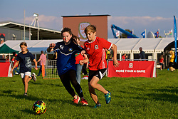 """NEWPORT, WALES - Thursday, August 30, 2018: A girl and boy playing football at the FAW supporters' """"Fan Zone"""" before the FIFA Women's World Cup 2019 Qualifying Round Group 1 match between Wales and England at Rodney Parade. (Pic by Laura Malkin/Propaganda)"""