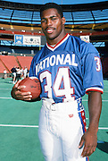 The National Football Conference Dallas Cowboys running back Herschel Walker (34) poses for a photo at photo day during the week before the 1989 NFL Pro Bowl football game against the American Football Conference on Jan. 24, 1989 in Honolulu. The NFC won the game 34-3. (©Paul Anthony Spinelli)