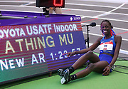 Athing Mu poses with scoreboard after winning the women's 600m in an American record 1:23.77 during the USA Indoor Track and Field Championships in Staten Island, NY, Sunday, Feb 24,2019. (Rich Graessle/Image of Sport)
