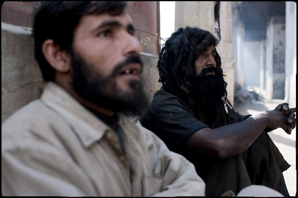 "Two drug users, one of the two (right) is hashish aabuser, the other (left) is heroin addict. Shan Nazar Kapull, Rawalpindi, Pakistan, on thursday, November 27 2008.....""Pakistan is one of the countries hardest hits by the narcotics abuse into the world, during the last years it is facing a dramatic crisis as it regards the heroin consumption. The Unodc (United Nations Office on Drugs and Crime) has reported a conspicuous decline in heroin production in Southeast Asia, while damage to a big expansion in Southwest Asia. Pakistan falls under the Golden Crescent, which is one of the two major illicit opium producing centres in Asia, situated in the mountain area at the borderline between Iran, Afghanistan and Pakistan itself. .During the last 20 years drug trafficking is flourishing in the Country. It is the key transit point for Afghan drugs, including heroin, opium, morphine, and hashish, bound for Western countries, the Arab states of the Persian Gulf and Africa..Hashish and heroin seem to be the preferred drugs prevalence among males in the age bracket of 15-45 years, women comprise only 3%. More then 5% of whole country's population (constituted by around 170 milion individuals),  are regular heroin users, this abuse is conspicuous as more of an urban phenomenon. The substance is usually smoked or the smoke is inhaled, while small number of injection cases have begun to emerge in some few areas..Statistics say, drug addicts have six years of education. Heroin has been identified as the drug predominantly responsible for creating unrest in the society."""