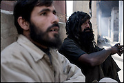 """Two drug users, one of the two (right) is hashish aabuser, the other (left) is heroin addict. Shan Nazar Kapull, Rawalpindi, Pakistan, on thursday, November 27 2008.....""""Pakistan is one of the countries hardest hits by the narcotics abuse into the world, during the last years it is facing a dramatic crisis as it regards the heroin consumption. The Unodc (United Nations Office on Drugs and Crime) has reported a conspicuous decline in heroin production in Southeast Asia, while damage to a big expansion in Southwest Asia. Pakistan falls under the Golden Crescent, which is one of the two major illicit opium producing centres in Asia, situated in the mountain area at the borderline between Iran, Afghanistan and Pakistan itself. .During the last 20 years drug trafficking is flourishing in the Country. It is the key transit point for Afghan drugs, including heroin, opium, morphine, and hashish, bound for Western countries, the Arab states of the Persian Gulf and Africa..Hashish and heroin seem to be the preferred drugs prevalence among males in the age bracket of 15-45 years, women comprise only 3%. More then 5% of whole country's population (constituted by around 170 milion individuals),  are regular heroin users, this abuse is conspicuous as more of an urban phenomenon. The substance is usually smoked or the smoke is inhaled, while small number of injection cases have begun to emerge in some few areas..Statistics say, drug addicts have six years of education. Heroin has been identified as the drug predominantly responsible for creating unrest in the society."""""""