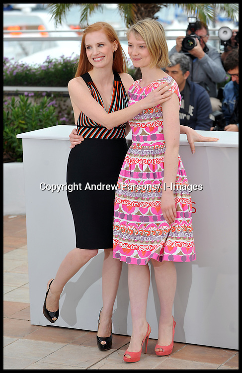 LTOR Jessica Chastain and Mia Wasikowska attend the photocall for the film Lawless at the Cannes Film festival, Saturday May 19, 2012. Photo by Andrew Parsons/i-Images.