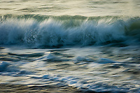 The blurred shape of a breaking wave at dawn, De Hoop Marine Protected Area, Western Cape, South Africa