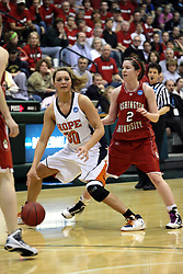 20 March 2010: Carrie Snikkers is flanked by Alex Hoover. The Flying Dutch of Hope College fall to the Bears of Washington University 65-59 in the Championship Game of the Division 3 Women's NCAA Basketball Championship the at the Shirk Center at Illinois Wesleyan in Bloomington Illinois.