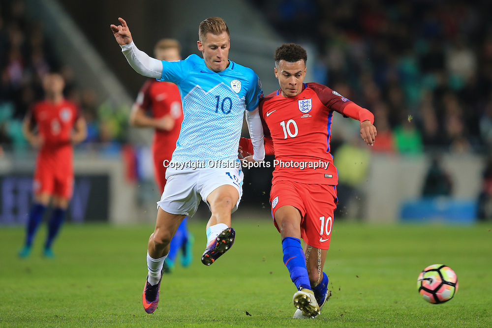 11 October 2016 - FIFA 2018 World Cup Qualifying (Group F) - Slovenia v England - Dele Alli of England in action with Valter Birsa of Slovenia - Photo: Marc Atkins / Offside.