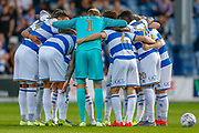 Queens Park Rangers player huddle before the EFL Sky Bet Championship match between Queens Park Rangers and Swansea City at the Kiyan Prince Foundation Stadium, London, England on 21 August 2019.