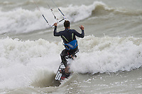 Kitesurfers and surfers enjoy the 24mph gusty southwesterly winds during the afternoon of Tuesday 28 July 2015 at Tide Mills in Seaford, East Suusex on the south coast of England, UK