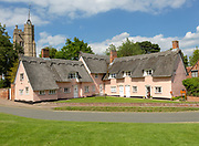 Attractive pink thatched cottages and church village of Cavendish, Suffolk, England, UK - Hyde Park Corner