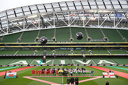 DUBLIN, REPUBLIC OF IRELAND - Friday, May 27, 2011: Wales' players line-up to face Northern Ireland in front of an empty stadium before the Carling Nations Cup match at the Aviva Stadium (Lansdowne Road). The official attendance was 529. (Photo by David Rawcliffe/Propaganda)