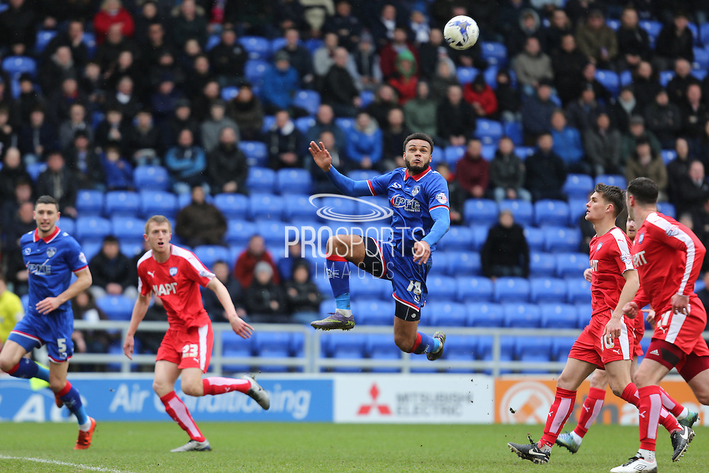 Aaron Amadi-Holloway of Oldham Athletic stretches to reach a cross during the Sky Bet League 1 match between Oldham Athletic and Chesterfield at Boundary Park, Oldham, England on 28 March 2016. Photo by Simon Brady.