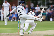 Gary Ballance of Yorkshire plays the ball as Tim Ambrose of Warwickshire tries to stop it during the Specsavers County Champ Div 1 match between Yorkshire County Cricket Club and Warwickshire County Cricket Club at York Cricket Club, York, United Kingdom on 17 June 2019.