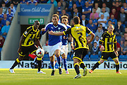 Chesterfield FC miffielder Dan Gardner surrounded by Burton players during the Sky Bet League 1 match between Chesterfield and Burton Albion at the Proact stadium, Chesterfield, England on 26 September 2015. Photo by Aaron Lupton.