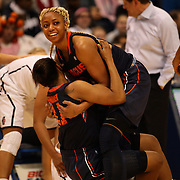 Elashier Hall, Syracuse, lifts team mate Cornelia Fondren, during the Connecticut V Syracuse Semi Final match during the Big East Conference, 2013 Women's Basketball Championships at the XL Center, Hartford, Connecticut, USA. 11th March. Photo Tim Clayton