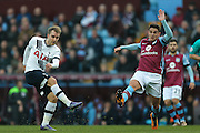 Tottenham Hotspur midfielder Christian Eriksen (23)  hits a shot just wide during the Barclays Premier League match between Aston Villa and Tottenham Hotspur at Villa Park, Birmingham, England on 13 March 2016. Photo by Simon Davies.