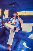 "Billy Carter - with beer in hand and cooler at his side - talks on an analog mobile telephone in the back of a Cadillac limousine. William Alton - Billy - Carter (March 29, 1937 – September 25, 1988) was an American farmer, businessman, brewer, and politician, and the younger brother of U.S. President Jimmy Carter. Carter promoted Billy Beer and was a candidate for mayor of Plains, Georgia. Carter was born in Plains, Georgia, to James Earl Carter Sr. and Lillian Gordy Carter. He was named after his paternal grandfather and great-grandfather, William Carter Sr. and William Archibald Carter Jr. respectively. He attended Emory University in Atlanta but did not complete a degree. He served four years in the United States Marine Corps, then returned to Plains to work with his brother in the family business of growing peanuts. In 1955, at the age of 18, he married Sybil Spires (b. 1939), also of Plains. They were the parents of six children: Kim, Jana, William ""Buddy"" Carter IV, Marle, Mandy, and Earl, who was 12 years old when his father died."
