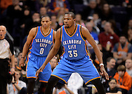 Jan. 14, 2013; Phoenix, AZ, USA; Oklahoma City Thunder forward Kevin Durant (35) and guard Russell Westbrook (0) play defense in the game against the Phoenix Suns at the US Airways Center. The Thunder defeated the Suns 102-90. Mandatory Credit: Jennifer Stewart-USA TODAY Sports