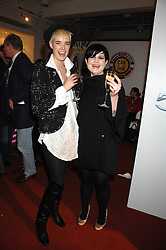 Left to right, AGYNESS DEYN and KELLY OSBOURNE at a party to celebrate the launch of the new Fiat 500 car held at the London Eye, Westminster Bridge Road, London on 21st January 2008.<br />
