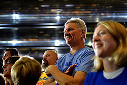 Supporters listen to Democratic vice-presidential nominee Tim Kaine as he delivers a speech at a post vice-presidential debate during a rally at Sheet Metal Workers Local Union 19 Hall in Philadelphia, Pennsylvania, USA, on October 5, 2016.