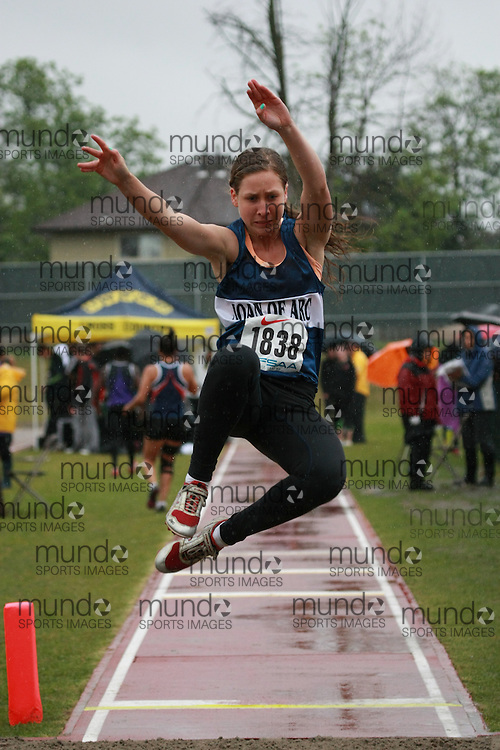 Brittany Graves of St Joan of Arc CHS - Barrie competes in the senior girls long jump at the 2013 OFSAA Track and Field Championship in Oshawa Ontario, Thursday,  June 6, 2013.<br /> Mundo Sport Images / Sean Burges