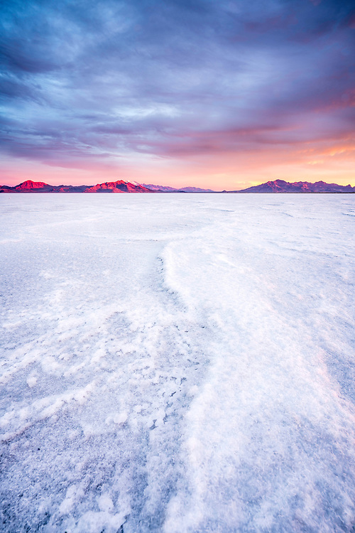 Sunrise over the cracks and ridges of the Bonneville Salt Flats in Western Utah.