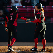 02 March 2018: San Diego State softball hosts Minnesota on day two of the San Diego Classic I at Aztec Softball Stadium. San Diego State shortstop Shelby Thompson (20) is congratulated by outfielder Zaria Meshack (2) after scoring to tie the game in the bottom of the second inning against Minnesota. The Aztecs beat the #21/20 Gophers 6-2.<br /> More game action at sdsuaztecphotos.com