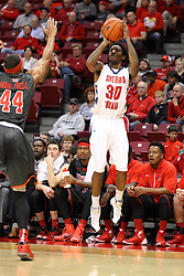 08 November 2015:  DeVaughn Akoon-Purcell(44) is out of position to stop a long distance call by Cortez Macklin(30). Illinois State Redbirds host the Southern Indiana Screaming Eagles and beat them 88-81 in an exhibition game at Redbird Arena in Normal Illinois (Photo by Alan Look)