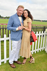 BORIS & LILLY BECKER at the Cartier Queen's Cup Polo final at Guard's Polo Club, Smiths Lawn, Windsor Great Park, Egham, Surrey on 14th June 2015