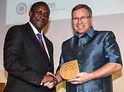 Dr Kandeh Yumkella, Director General of the United Nations Industrial Development Organisation. (UNIDO) presenting an international award to  Michael Roberts of iDE and Hydrologic. The 2012 Ashden Awards for sustainable energy ceremony at the Royal Geographical Society. London.