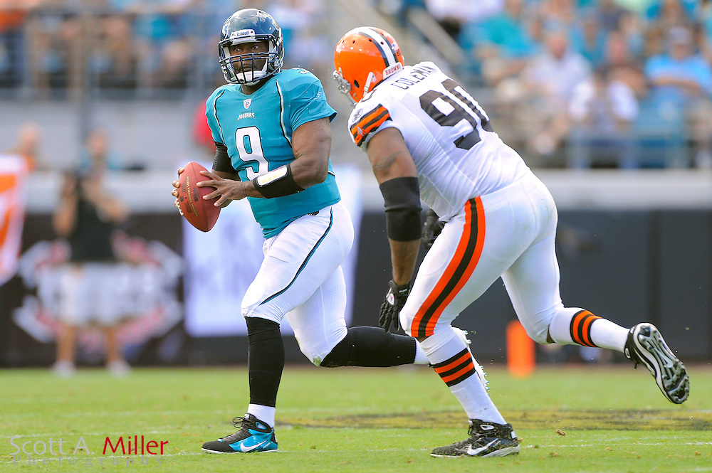 Jacksonville Jaguars quarterback David Garrard (9) is chased by Cleveland Browns defensive end Kenyon Coleman (90) during the Jags 24-20 win over the Browns at EverBank Field on Nov. 21, 2010 in Jacksonville, Florida. ..©2010 Scott A. Miller